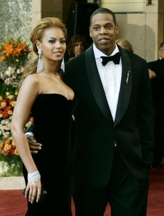Beyonce & Jay Z, my favorite picture of this couple.  She looks like a wife here.  Elegant in her velvet gown, with her controlled mane, and large crystal drop earrings, with J in his tux.  They look like royalty.