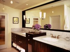 Mirror, Mirror, On the Wall -Designer Kenneth Brown used a large-scale mirror to make this small bathroom appear more spacious. The large looking glass also provides ample space for two people to get ready in front of the double vanity.