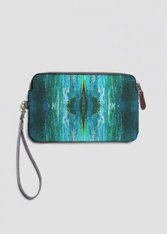 Accent your outfit with our chic custom printed Leather Statement Clutch featuring a top zip closure and removable wristlet strap by artist Alicia Noelle Jones @anoellejay @shopvida