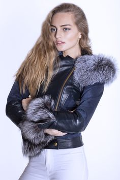 This fabulous biker jacket is the epitome of British made excellence.  This luxurious piece will ensure that you are at the top of the fashion stakes this year. <br /> <br /> Trimmed with the finest silver fox fur this stylish biker jacket oozes luxury and glamour.   The tailored cut creates a flattering shape on all figures. <br /> <br /> The main body of the jacket is made from the finest navy suede and leather.   The sleeve has been cut slightly longer to allow the cuff to be turned up to…