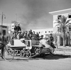 The British enter Benghazi, Libya. Local children are given a ride on a Bren gun carrier in Benghazi, November 1942.