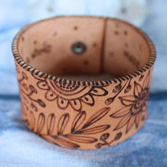 Image of Wood Burned Leather Botanical Cuff by Geninne: