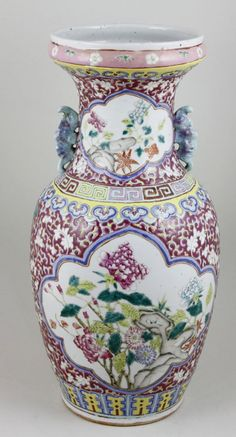"Porcelain vase, China, Qing Dynasty (1644-1911), the baluster form painted with vignettes of peonies and rock formations, with scrolling lotus flowers and the longevity character on red ground, green glazed bat handles, the flared rim embellished with a border of ruyi and floral designs, 17 1/4""h x 8 1/2""w."