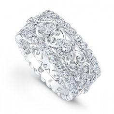 Spectacular 18K white gold and diamond floral band designed by Beverley K.