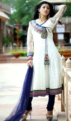 Phenomenal off white color cotsilk kalidar kurta with stylish stitch work triple patch on hemline, sleeves bottom and thread work sleeves are giving bloom to it. Glorious sequins, cutdana, diamantes, jardozy, jari, resham embroidery work paisley motifs and stitch work layered brocade patch on neckline with trendy latkans are making it extraordinary creation.