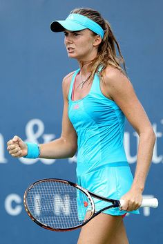 The Most Iconic and Stylish Tennis Outfits of All Time: Daniela Hantuchova celebrates match point during the Western  Southern Open in Ohio, August 2011, in head-to-toe turquoise.