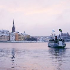 This morning was fantastic with pink hues across the sky. The snow is turning the city into a winter wonderland! ❄️ #visitstockholm
