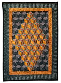 "Diamond Blocks quilt, 32½"" x 47"" by Tom Cuff. 1st Prize — Pieced, Hand Quilted, Small.  2009 Empire Quilters Guild: Showcase"