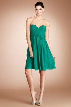 This flirty dress in a deep color works equally well for a cocktail party as a wedding