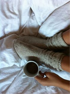 Cozy socks and a cup of coffee #cupofcoffee #cozy #inbed