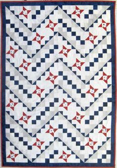 "SGT. STANLEY, 52"" × 76"", by Eve Hanssen-Wood. Designed by Kate Colleran and Elizabeth Balderrama at Seams Like a Dream Quilt Designs. It uses three different 9-patch blocks: the Friendship Star, an ""ordinary"" 9-patch, and a 9-patch with squares from half-square triangles on the diagonal."