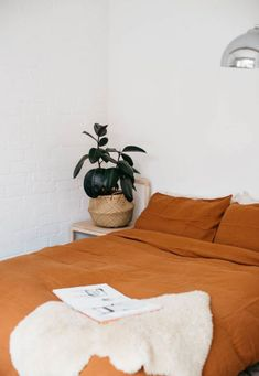 burnt orange bedding in bohemian modern white room. / sfgirlbybay