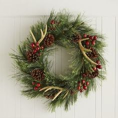 With its fabulous faux antlers and specimen-quality pinecones, our exclusive wreath is just right for rugged outdoorsy types and decor mavens alike. The faux berries add an extra dose of holly jolly to the whole ensemble, making it perfect for entryway, mantel or window. Any way you look at it, there's a lot to like.