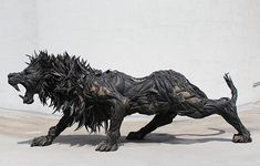 Lion in Stainless Steel and Used Tyres by Yong Ho Ji  http://yonghoji.com/db/index.php?/carnivorous/lion/
