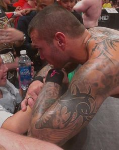 Randy visiting with a young fan in the crowd. How sweet is that?!