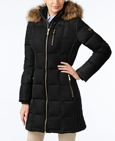 Warmth and comfort come together in this puffer coat from Michael Michael Kors, framed perfectly with a soft faux-fur-trim hood.   Nylon; lining: polyester; knit trim: acrylic; faux fur trim: modacryl