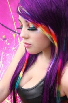 Purple hair with rainbow strands shes a fascinating diva.