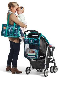 New Thirty-One Fall 2014 item.....On-A-Stroll-Bag in Navy Lotsa Dots! Great to use on a stroller, walker, or on a wheel chair! Also available in Black Chevron! #ThirtyOne #OnAStrollBag #Fall2014