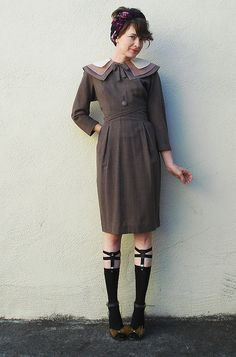 Vintage style dress, layered collar, and sock garters.