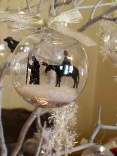 tutorial for inserting images into a ball:  http://bobobbin.blogspot.com/2012/11/tutorial-for-ornament-inserts.html#!/2012/11/tutorial-for-ornament-inserts.html