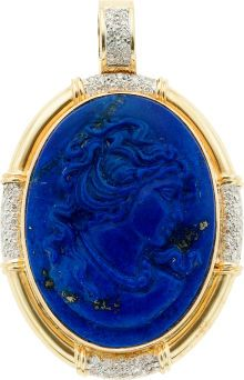Lapis Lazuli Cameo, Diamond, Gold Pendant The enhancer features an oval-shaped carved lapis lazuli cameo measuring 30.00 x 40.00 mm depicting a lady's profile, enhanced by full-cut diamonds weighing a total of approximately 0.60 carat, set in 14k gold. Gross weight 31.10 grams.  V
