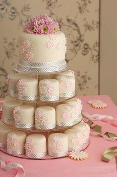 """Pink Bloom"" mini-cakes from Maisie Fantaisie, London. Madagascar vanilla bean cake, vanilla bean buttercream, raspberry preserve, VV Rouleaux ribbon, handmade sugar flowers.                                                                                                                                                                                 Mais"