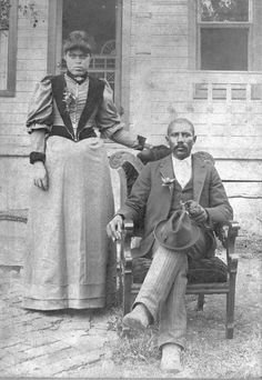 """Matilda and Junius Groves: A portrait of Matilda and Junius Groves, who were potato farmers near Edwardsville in Wyandotte County, Kansas. They farmed over 1,000 acres, and he was known as the """"Potato King."""" The Groves shipped their produce all over the United States by railroad. Because of the quantity shipped, the Union Pacific placed a spur on the Groves' farm to load its produce. Junius Groves served as trustee for Western University in Quindaro, Kansas."""