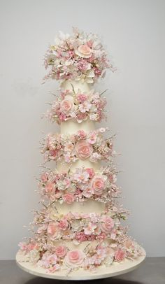 This five tiered wedding cake by Sylvia Weinstock is separated by 5 layers of delicate pink sugar flowers. Description from toovia.com. I searched for this on bing.com/images
