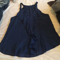 Brand new dark blue blouse Tucks in well or can be worn with jeans/dark leggings. Tops Blouses