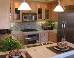 Kitchen Glass Backsplash Ideas Pictures The kitchen backsplash saves your walls from becoming a spagetti and gravy covered mess. Kitchen Stove, Glass Kitchen, Kitchen Backsplash, Kitchen Decor, Green Tile Backsplash, Backsplash Ideas, Kitchen Lighting Design, Primitive Kitchen, Primitive Crafts