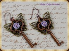 Antique Copper Butterfly Key Floral Dangle Earrings by battybettysboutique. Explore more products on http://battybettysboutique.etsy.com