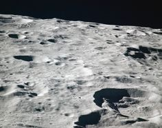 View of the Moon's Van Gent and Nagaoka Craters. Image was taken during Revolution 18 of the Apollo 16 mission. Approximate altitude was 118 kilometers.