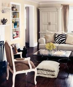 Enliven a monochromatic living room with a bold animal print accessory.