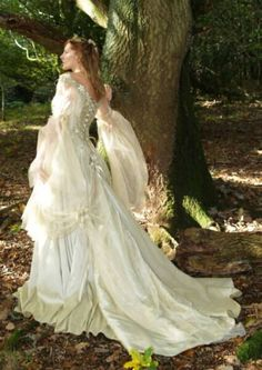 Owning a gown such as this, allows pass times that may include meandering wooded trails in search of enchanted princes or High Tea in a secret garden with the fairies.