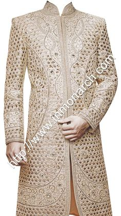 Royal rajwada pattern attractive cut work wedding sherwani made from cream color brocade fabric. Hand embroidered as shown. It…