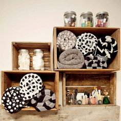 Use bins or woven baskets as wall-mounted shelves in your bathroom or for books and nic nacs