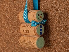 What better excuse to share a bottle of wine (or two!) with friends and family around the holidays. Save your wine corks for these cute, crafty, wine cork ornaments that could be used to decorate your tree or be given as a gift. Materials:  10 or more wine corks, depending on which craft you are making Hot glue gun Acrylic paint Rhinestones Small wooden ball Ribbon or twine   Snowman Requires three wine corks  Attach two wine corks together, side to side, with hot glue. Wrap a piece of…