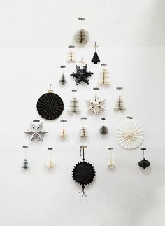 Home sweet home chez Madam Stoltz (PLANETE DECO a homes world) - A Christmas tree with a difference: simply glued to the wall with black and white ornaments and Chr - Noel Christmas, Scandinavian Christmas, Modern Christmas, Winter Christmas, All Things Christmas, Christmas Crafts, Christmas Ornaments, Minimalist Christmas Tree, Office Christmas