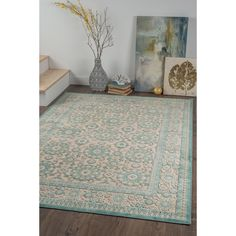 Stir sweetness into any room with this nostalgic traditional area rug. Raised chenille medallions and border in teal and seafoam on an ecru background. Made of ultra-soft viscose yarn that is naturally stain-resistant, with cotton backing for a flexible f