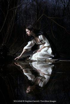 Stephen Carroll WOMAN IN WHITE DRESS KNEELING BY RIVER Women