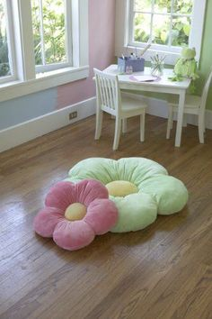 These daisy flower floor pillows are a great idea for the playroom.: