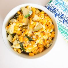 Summer fresh zucchini and corn never tasted so good tossed in lime, oregano and basil smothered in parmesan cheese.