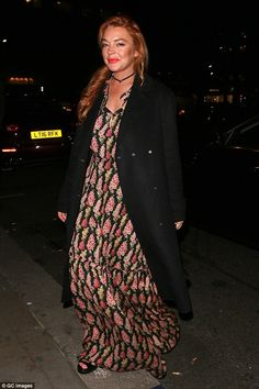 Back in town: Lindsay Lohan was back in her one-time home city on Thursday night, dressing to impress for a fashionable event in the capital