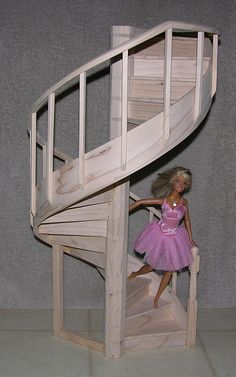 Sweet stairs to go inside the Doll house made out of the chest of drawers.