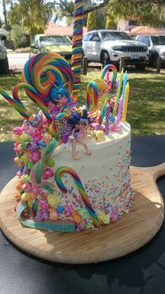 Rainbow lollipop fairy sprinkles buttercream mud cake. Girls 4th birthday celebration cake.