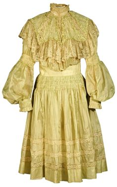 Girl's Pouter Pigeon, 1900-1910.  The short skirt of this Pouter Pigeon dress was typical for girls, who generally wore shorter dresses until they were older.    White cotton lace inserts offset the pale green silk of this dress. Its high lace collar is lined with wire supports to keep it standing upright.