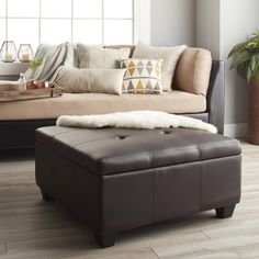 Featuring a square tufted design with double stitching, this ottoman is sure to add a touch of style and sophistication to any space. Child safety hinges ensure that no fingers will be smashed in this beautiful ottoman. Fabric Storage Ottoman, Round Storage Ottoman, Furniture Deals, Furniture Outlet, Online Furniture, Black Ottoman, Storage Spaces, Toy Storage, Living Room Furniture