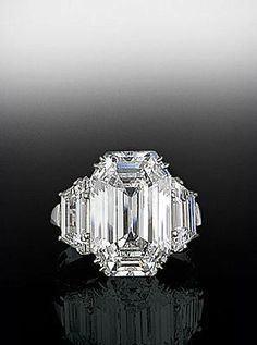 Emerald cut center diamond with trapezoid diamonds on either side. By  Bez Ambar.  Avalable at Alson Jewelers.