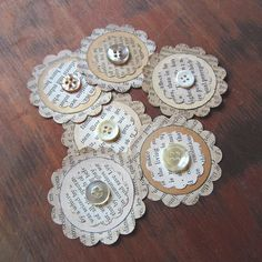 Paper flowers made from vintage books & buttons.