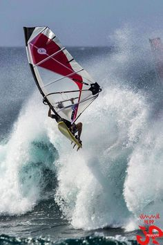I believe this would be the sport of wind-surfing.